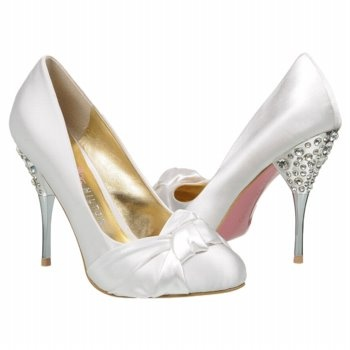 Paris Hilton Spelled white wedding shoes